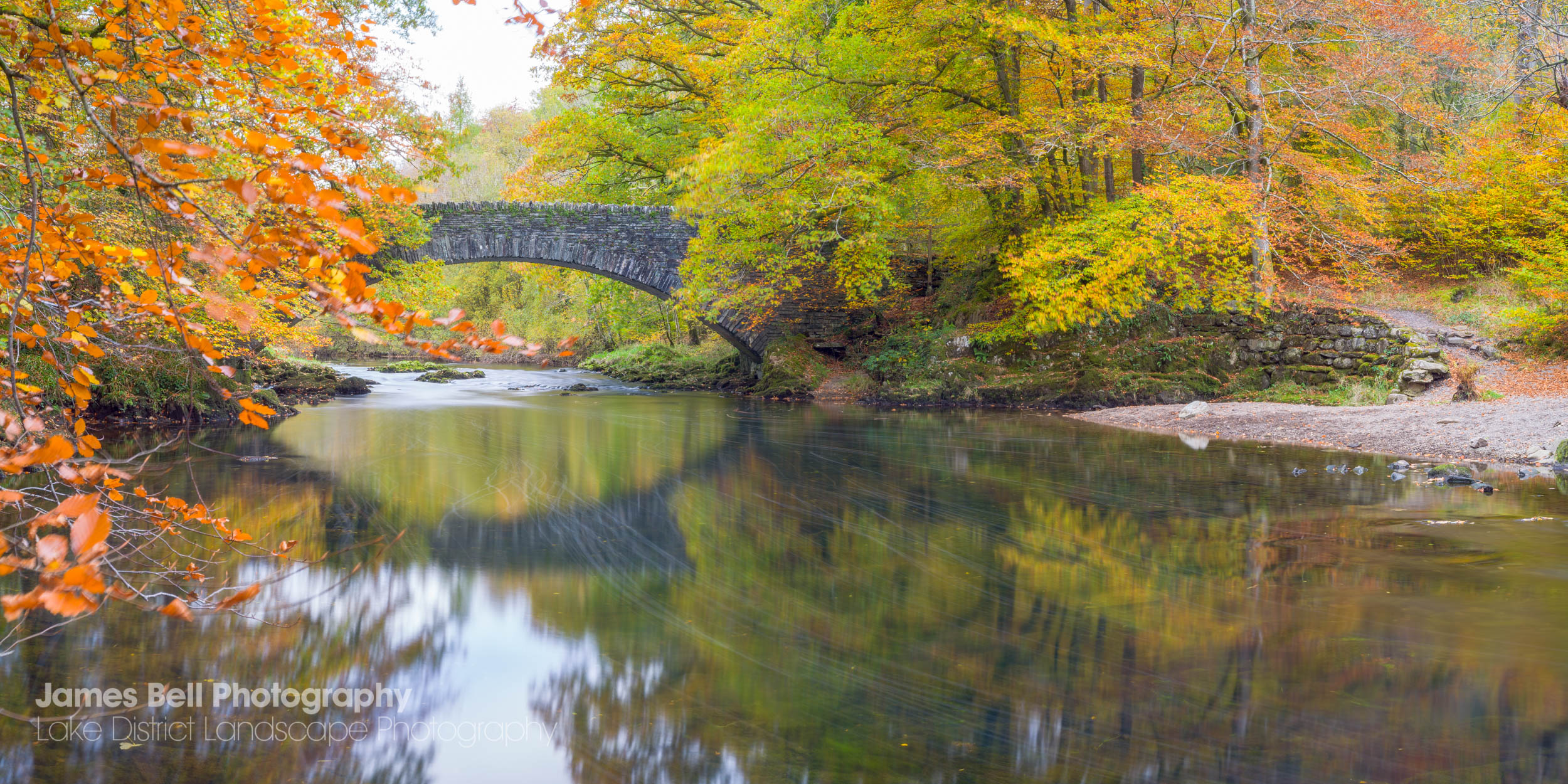Clappersgate Bridge over the River Brathay in Autumn